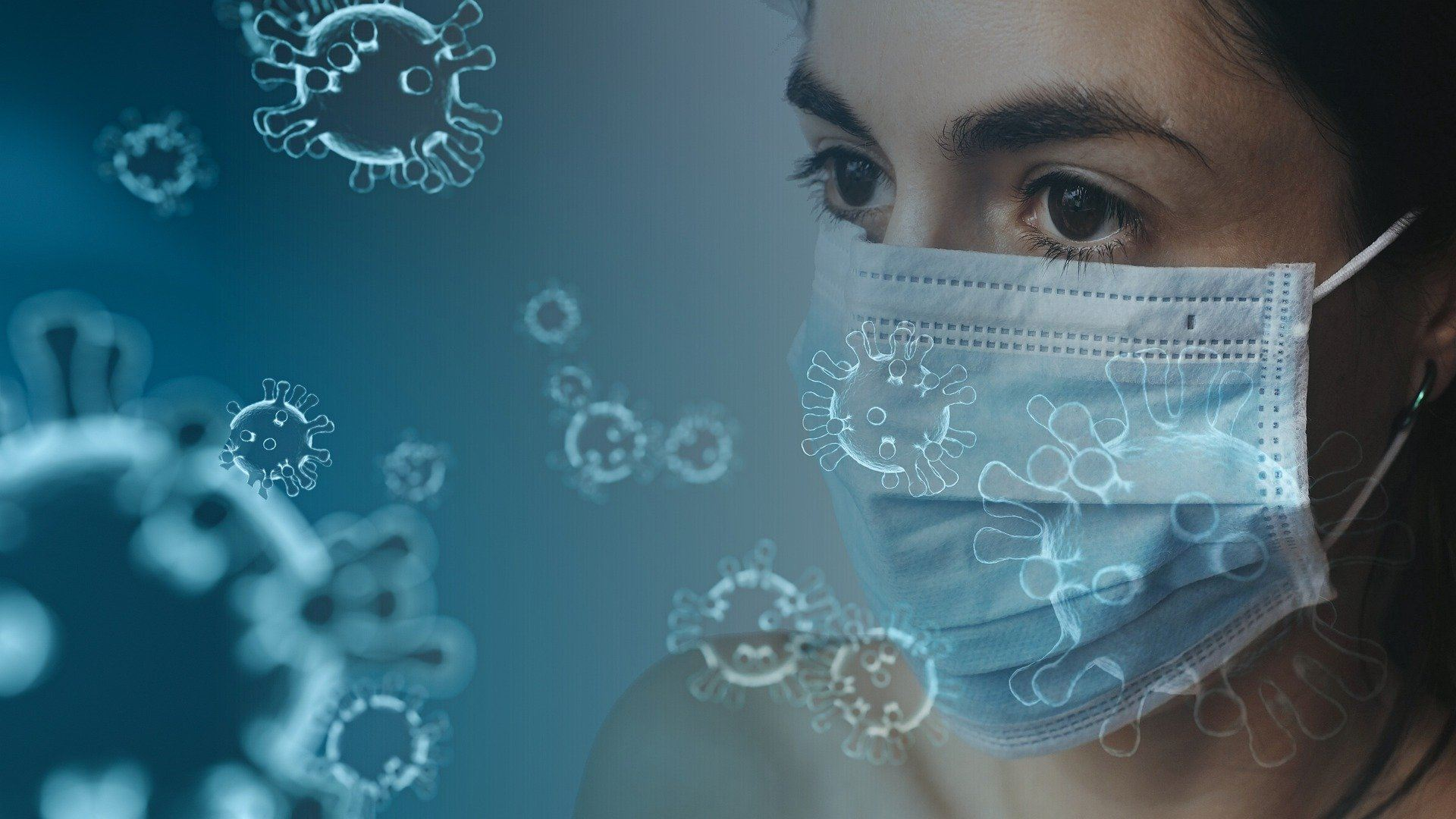 Frau mit Mundschutz zwischen Viren